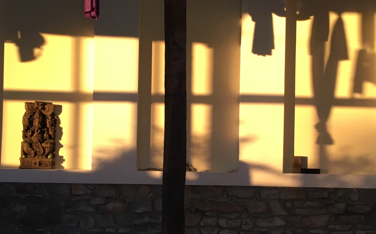 Indoor view of a yoga center at sunset