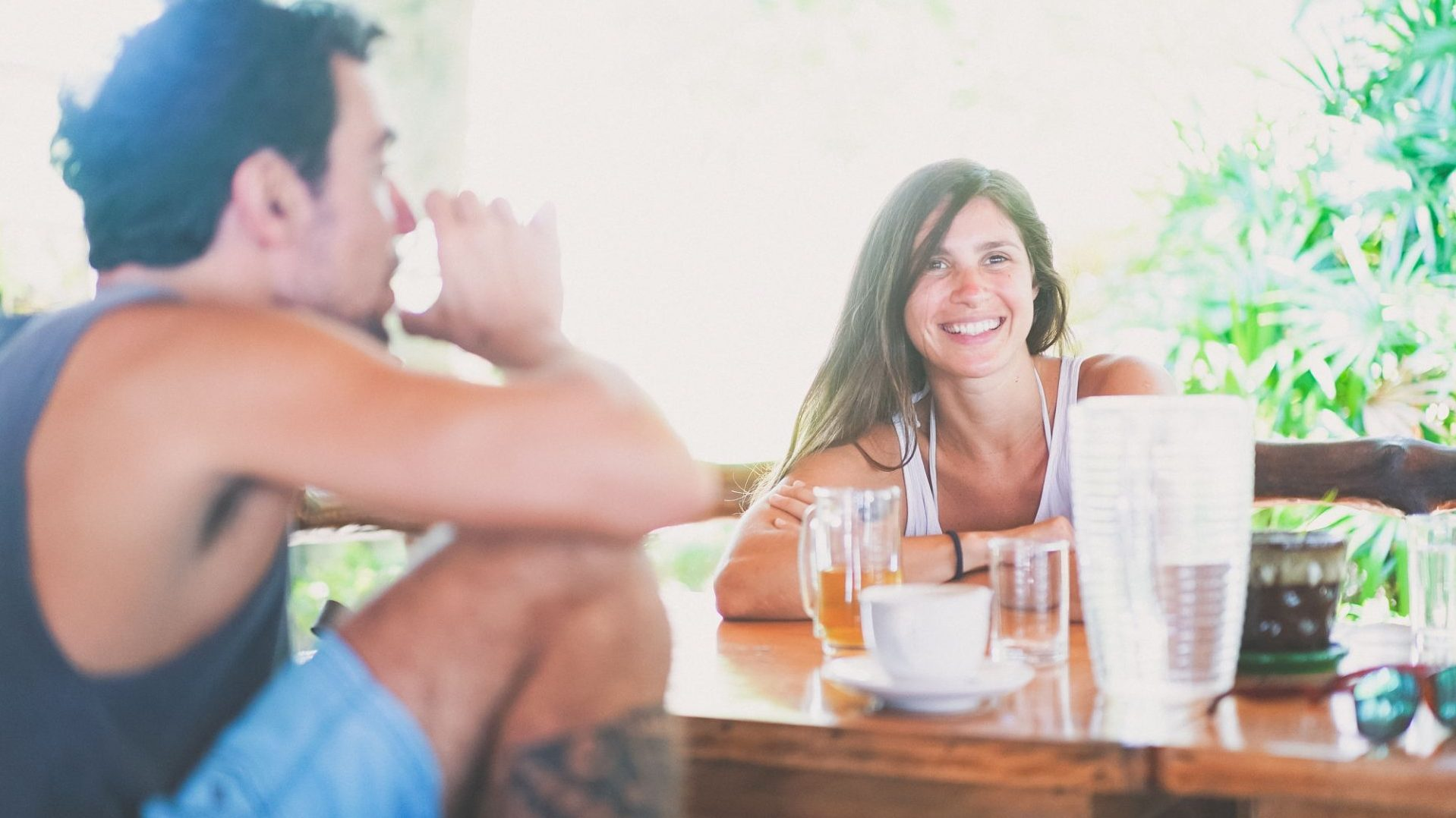 Two people smiling while drinking healthy drinks